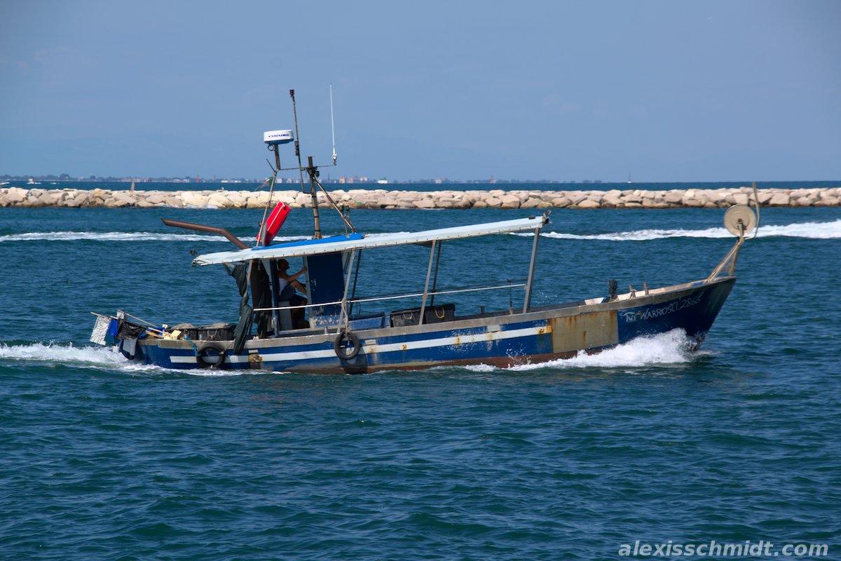 Fisherman cruising in his Boat in Chioggia, Italy