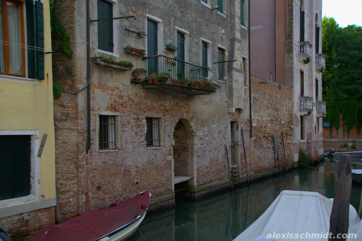 Canal, Boats and Red Brick House in Venice, Italy