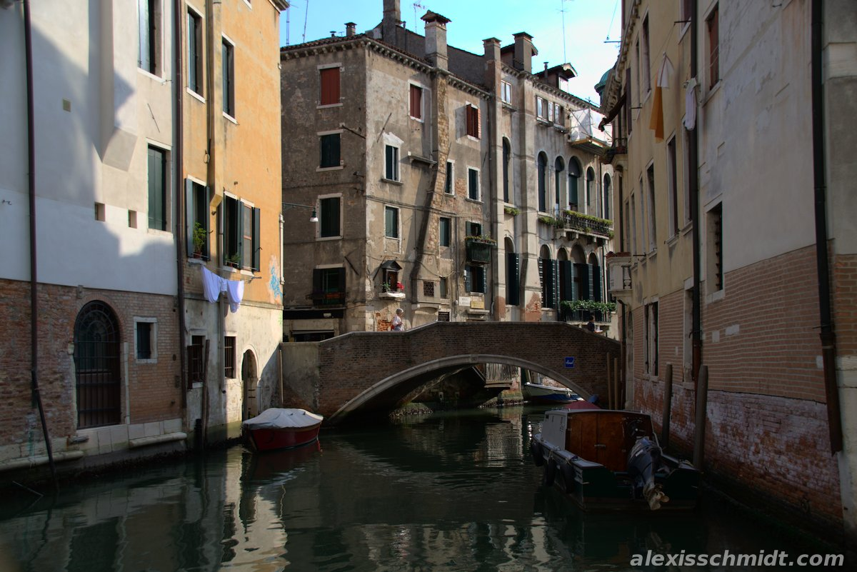 Canal, Bridge, Boats and Old Houses in Venice, Italy
